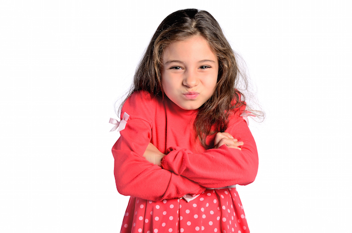 isolated child girl upset arms crossed on white background