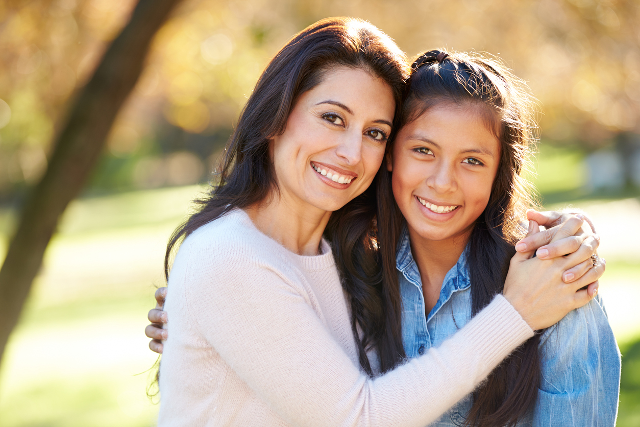 Portrait Of Mother And Daughter In Countryside Smiling To Camera