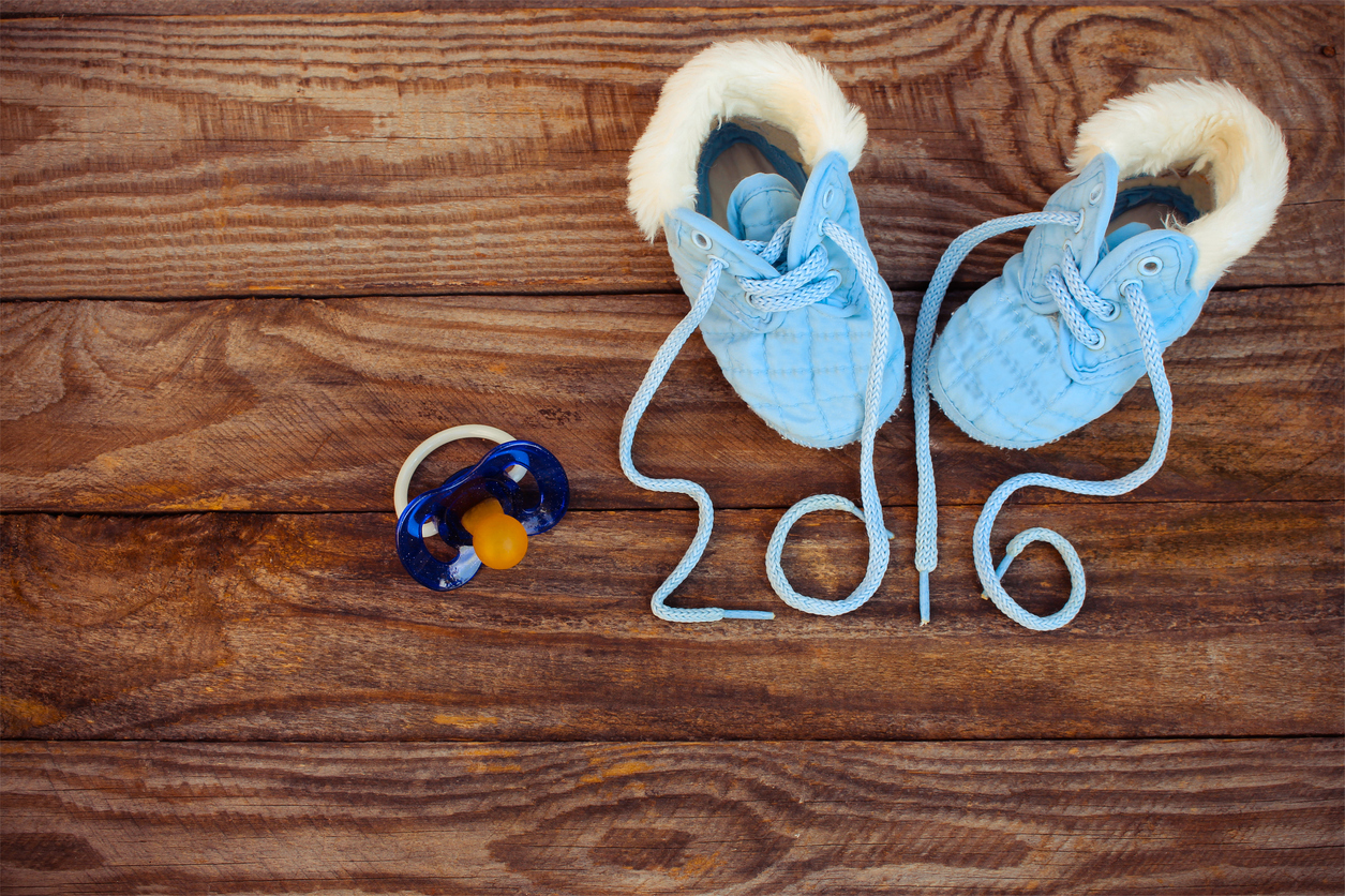 year 2016 written laces of children's shoes and pacifier